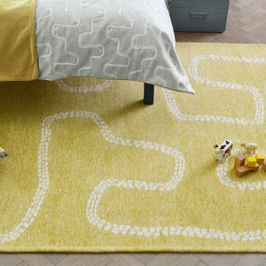 Pitter Patter Rug Sandpit in a room setting